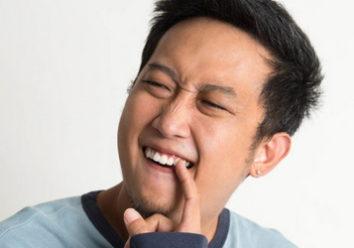 Почему шатается зубной имплант?
